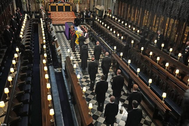 Members of the royal family follow the coffin into St George's Chapel during the funeral of the Duke of Edinburgh, at Windsor Castle