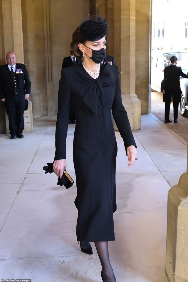 Kate Middleton recycled a chic black £1,605 Roland Mouret dress with an asymmetrical neckline to attend the funeral of Prince Philip today