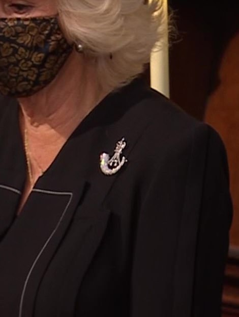 Camilla wore the silver Bugle Horn brooch of The Rifles on her black coat as she accompanied her husband Prince Charles to Prince Philip's funeral at St George's Chapel today