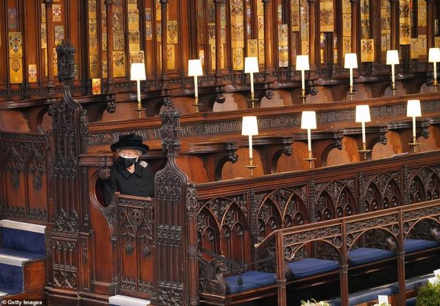 The Queen takes her seat during the funeral of Prince Philip, Duke of Edinburgh, at St George's Chapel at Windsor Castle