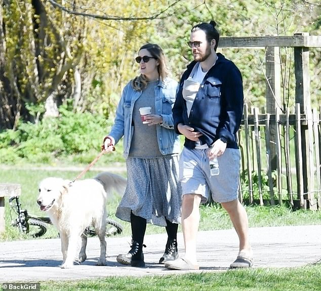 Family outing:Sophie Rundle and her partner Matt Stokoe looked every inch the doting new parents as they took their little boy on his first trip to the park on Saturday