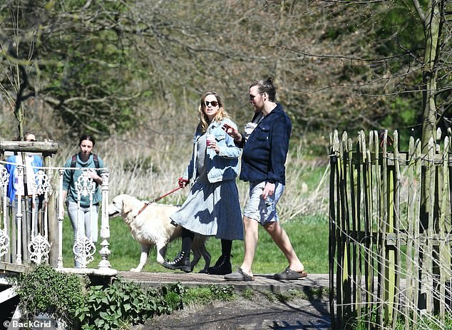 Out and about: Several other people were seen strolling past the new family