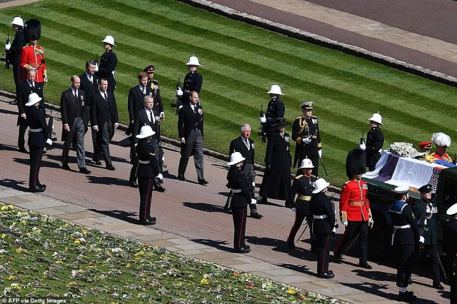 Members of the Royal family march behind the coffin during the ceremonial funeral procession of Britain's Prince Philip