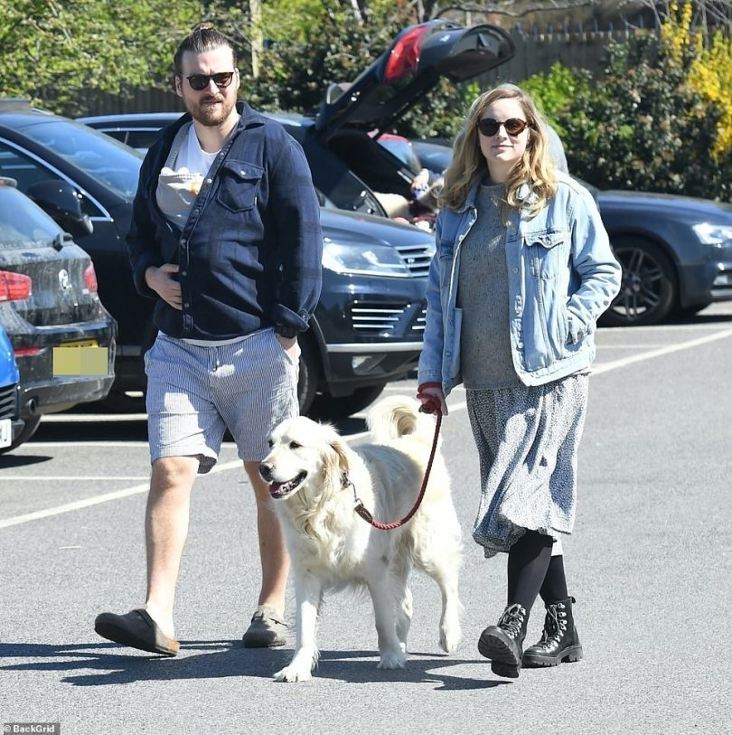 Family outing: Sophie Rundle and her partner Matt Stokoe looked every inch the doting new parents as they took their little boy on his first trip to the park on Saturday