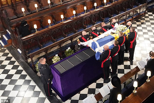 Philip's coffin had its standard, navy blue bonnet and a sword given to it by the Queen's father when they were married 73 years ago as the Queen sat alone to the left as she was placed in front of the altar.
