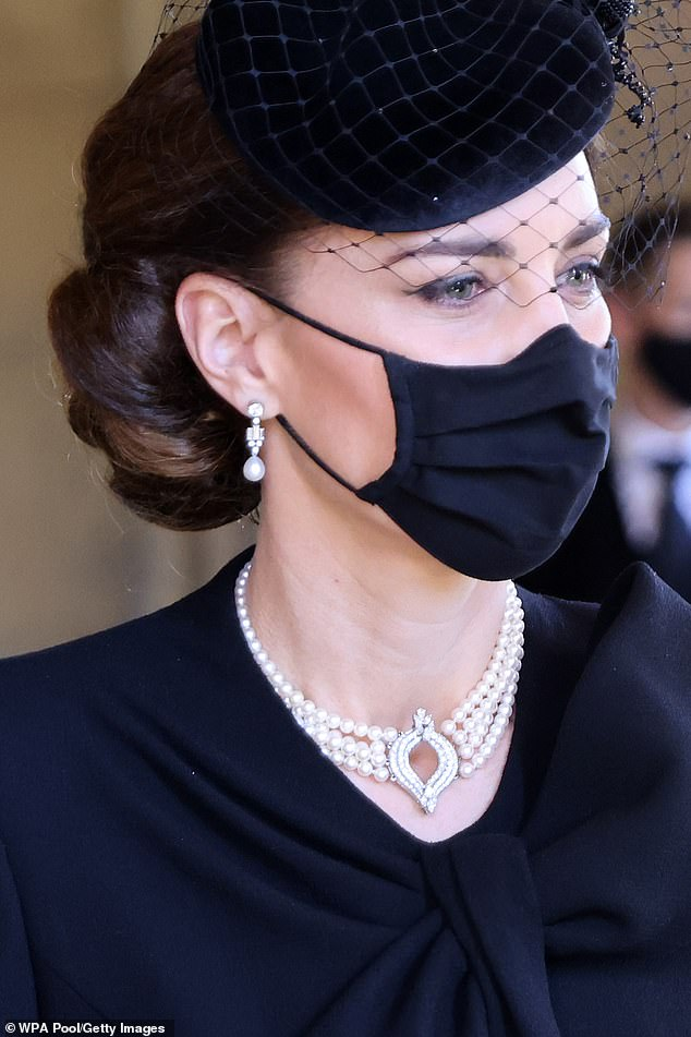 She paired her outfit with the Japanese pearl choker necklace and Bahraini diamond earrings which also came from Her Majesty's private collection.