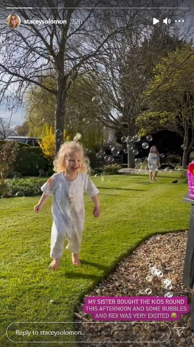 Fun in the sun: The Loose Women panelist, 31, said her sister Jemma and her children came to play in the garden on Saturday and brought a bubble machine.