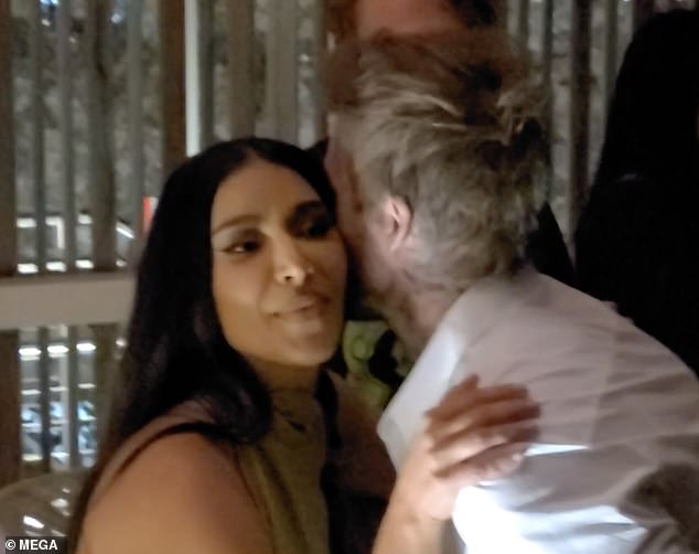 Hi there! David Beckham and Kim Kardashian greeted each other with a hug and kiss at Pharrell Williams and David Grutman's Goodtime Hotel grand opening party in Miami on Friday