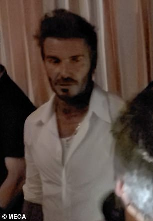 Hunky: His top wasleft partially opened to display his white vest