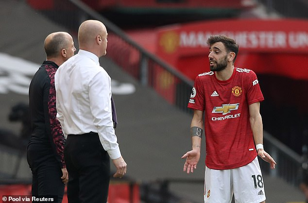 Bruno Fernandes has an arguement with Burnley manager Sean Dyche in the second-half