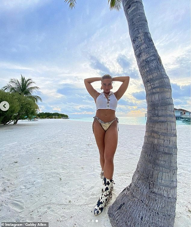 Work it: Gabby looked incredible as she worked all her angles for the camera while soaking up the sunshine at the beach