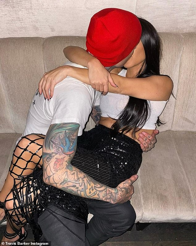 Happy boyfriend: Travis Barker was seen passionately kissing his girlfriend Kourtney Kardashian in a photoset that he uploaded to commemorate her 42nd birthday on Sunday