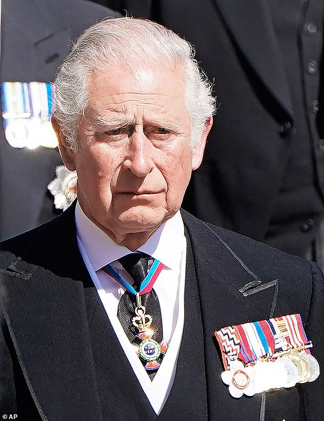 As the limousines drew up to take mourners from the Galilee porch of St George¿s Chapel back to Windsor Castle¿s private quarters, Prince Charles used the briefest of gestures to send them, empty of their royal passengers, away.