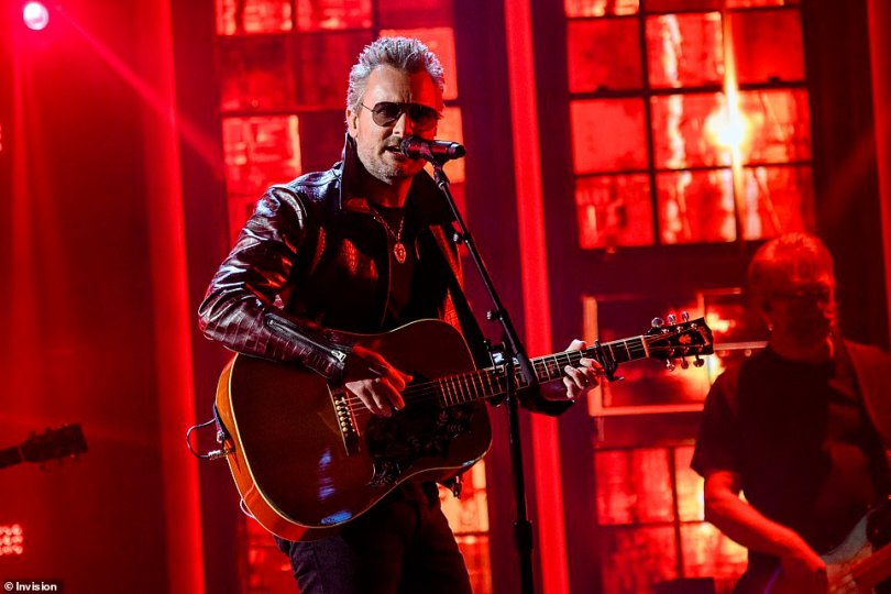 Rocking out:Eric Church helped pick up the energy after Carrie Underwood's religious performance with a rocking out with his new song Bunch Of Nothing