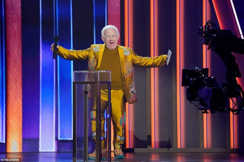 TV star:Will & Grace actor Leslie Jordan looked fabulous in a lustrous yellow suit with special embroidery. He was overjoyed to be introduced by Dolly Parton, before presenting the award for Duo of the Year