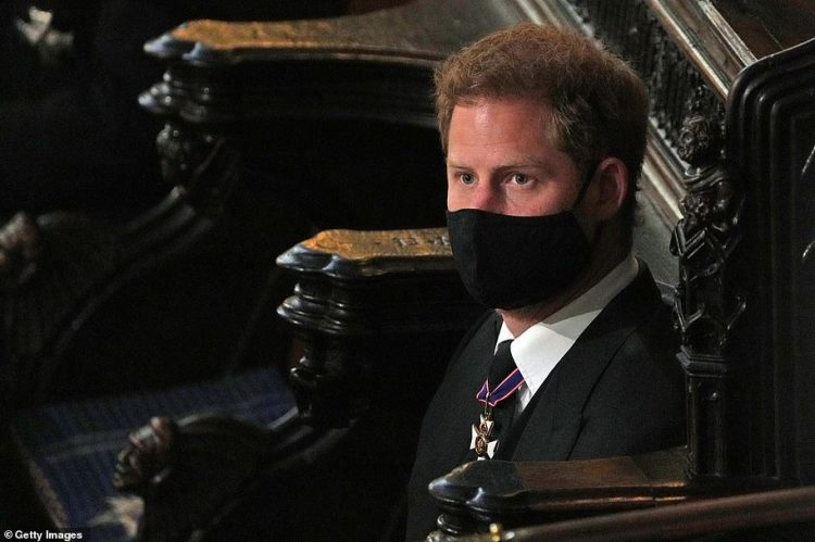 Prince Harry was sat directly across from his older brother and his wife Kate having flown in without his wife Meghan