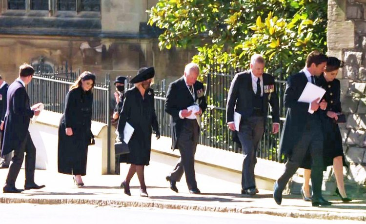 Prince Charles and members of the royal family walk outside St George's Chapel during the funeral service of Prince Philip