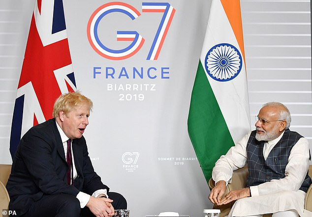 Yesterday, a joint statement from the British and Indian government said Boris Johnson's (pictured with Indian Prime Minister Narendra Modi) trip - will not go ahead