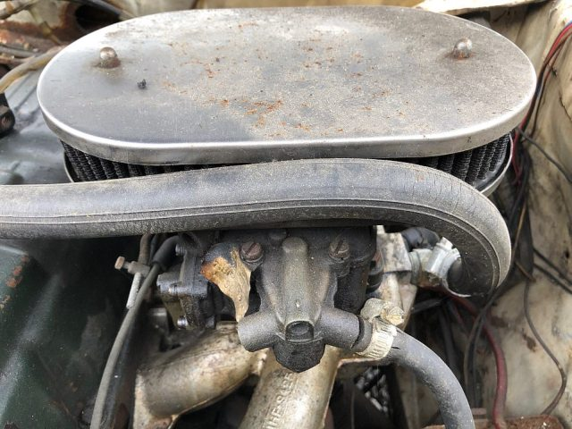 The car has spent years hidden away underneath a pile of junk inside a Dorset garage. It is thought that it was last on the road nearly 25 years ago and has since been left to rot. Pictured: The car's engine, which is in need of full restoration before it will be roadworthy again