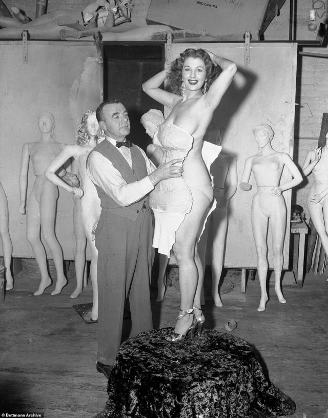 Designer James Berry strips tape and and jersey form from Storm's body following a show in the 1950s