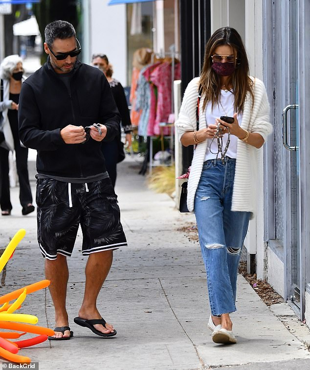 Casual: As for Richard, he remained ultra casual for his outing with Alessandra in a zip-up jacket, patterned shorts and flip flops