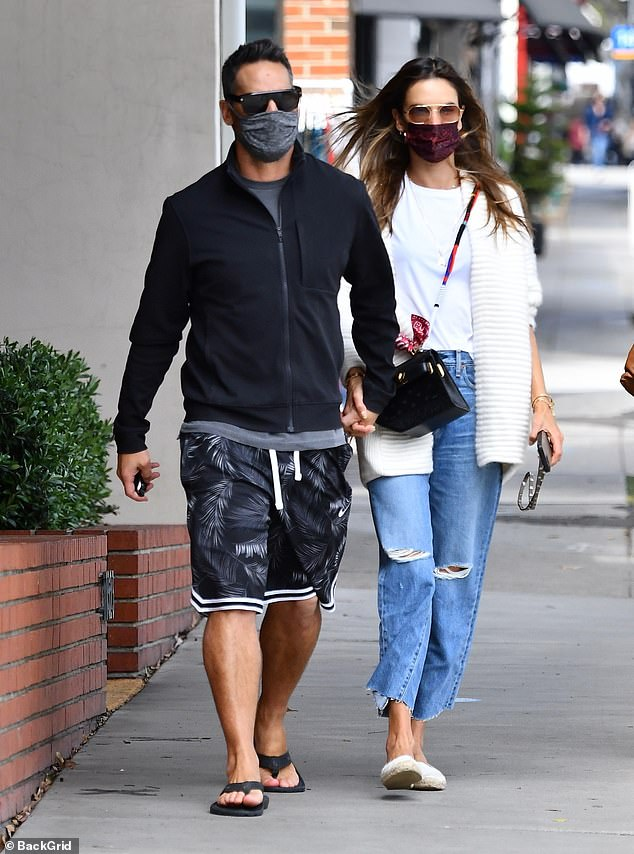 Lunch date: The former Victoria's Secret Angel, who rang her 40th birthday earlier this month, held the hunky model's hand as they had lunch in Brentwood, Calif.