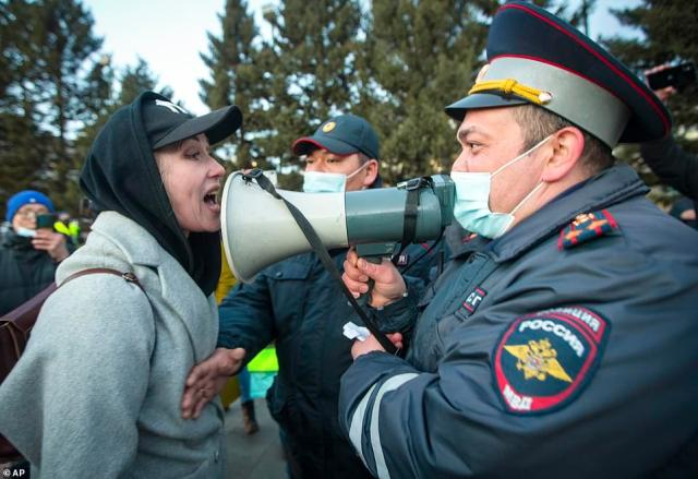 A woman argues with a police officer using a megaphone during a protest in Ulan-Ude, near the Russian-Mongolian border, on Wednesday