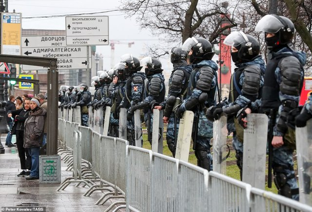 A similar police presence was seen in St Petersberg, where heavily armed officers guarded Palace Square as tens of thousands of protesters took to the streets
