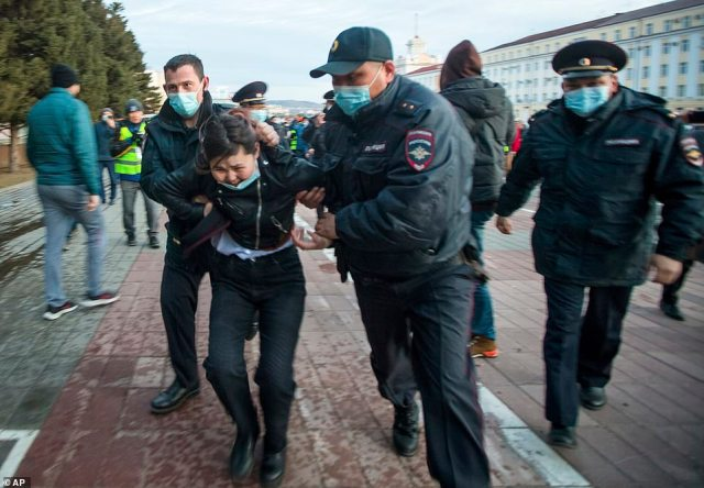 Russian authorities warned protesters the demonstrations had not been authorised and warned against participating in them, but thousands still came out on Wednesday (pictured, a woman is arrested in Ulan-Ude)