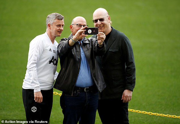 The protestors claim manager Ole Gunnar Solskjaer (pic alongside the Glazers in 2019) told the protestors: 'Joel (Glazer) loves the club'