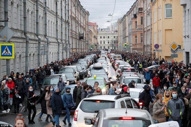 Thousands of demonstrators flood through the streets of St Petersburg on Wednesday as another protest took place in Moscow