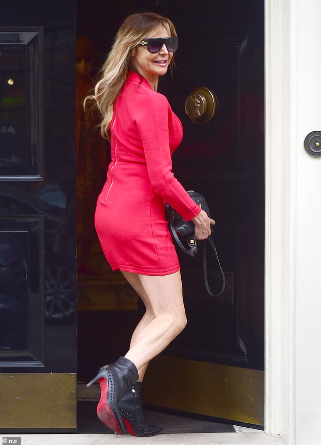 She's pleased: As always the former WAG greeted onlookers with a characteristically warm smile during her outing on Thursday morning