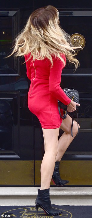 There she goes: Lizzie pushed open the doors as she made her way into the swanky London venue