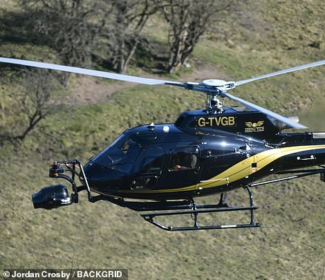 Busy: Tom and Hayley were being filmed from multiple different cameras on set, including from the helicopter
