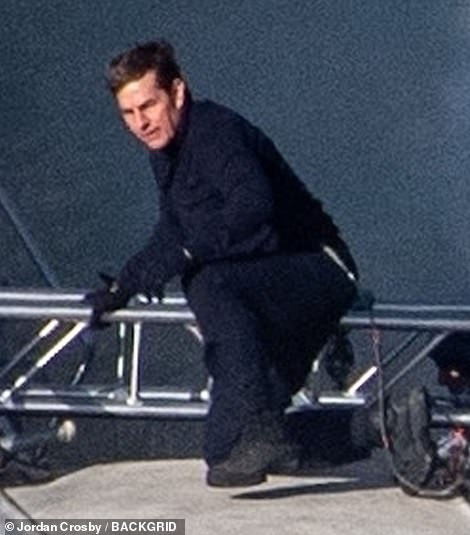 Dramatic: Tom Cruise and 'girlfriend' Hayley Atwell proved to be a daring duo as they RAN on top of a moving steam train while filming action-packed scenes for Mission Impossible 7 at the the North Yorkshire Moors railway on Thursday