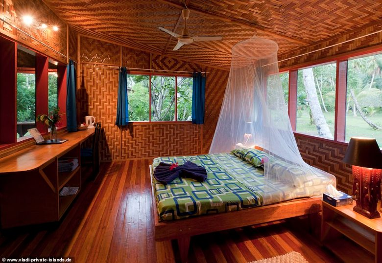 There are four two-bedroom bungalows featuring thatched roofs and traditional woven walls