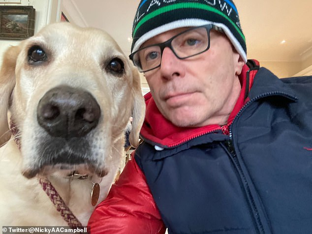 """Relief:Sharing how he felt at doctors finally giving him an answer to how he was feeling, Nicky recalled: 'I said """"aah that's what it is"""", I've got something it's normal, just like being ill' (pictured with 'miracle dog' Maxwell"""