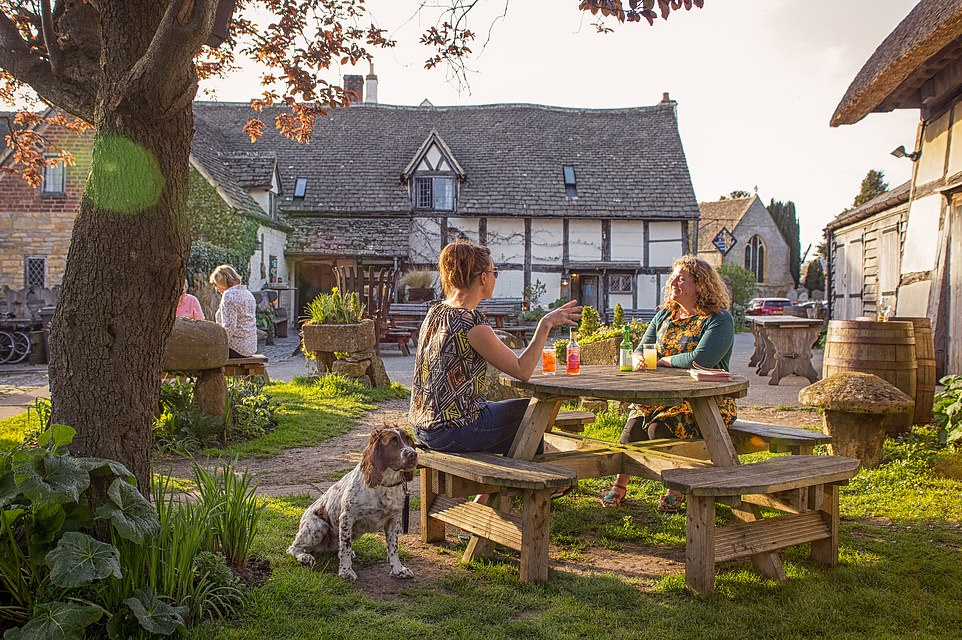 The beer garden at the Fleece Inn in Bretforton near Evesham.The pub is owned by the National Trust and was originally built in the 15th century