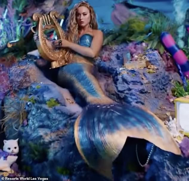 Wow:The Roar singer has been animated onto an underwater rock and has been given flowing blonde hair as well as a harp