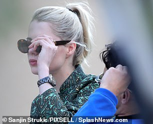 Simple: Lucy went for a stylish green print jacket and sunglasses