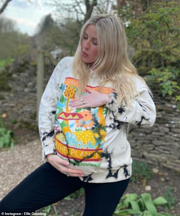 Important Cause: Pregnant Ellie Goulding looked as radiant as ever when she modeled a sweater by her close 'dear friend' Stella McCartney to mark Earth Day on Thursday