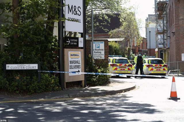 A police officer stands beside a cordon at the junction of Cloister Court and Church Street, Walton-on-Thames, Surrey, where the incident took place yesterday