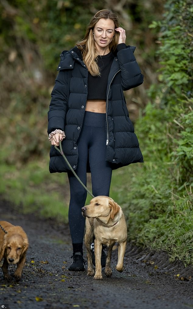 The PR executive walked with a friend and her Labrador, Mac, two weeks after the 'disturbance,' at the home she shared with the ex-footballer in Worsley, Salford