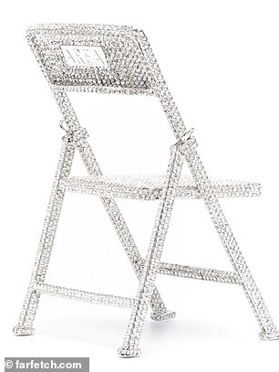 """It is a 5.75"""" folding chair figurine covered in pavé crystal embellishments, with no actual 'bag' to hold anything in"""