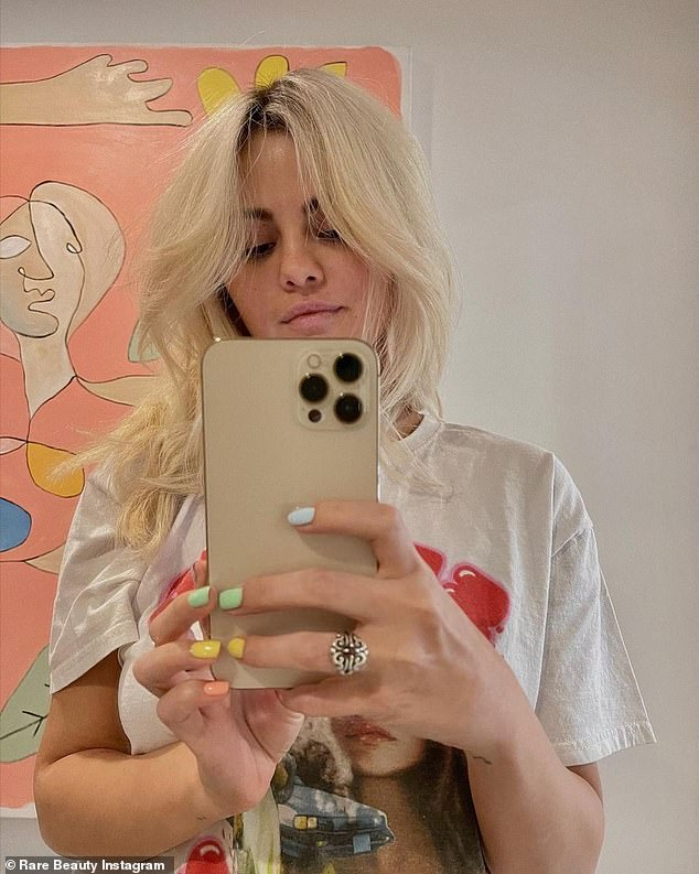 Blonde ambition: Selena Gomez, 28, goes blonde as she debuts her drastic 'new look' on Instagram