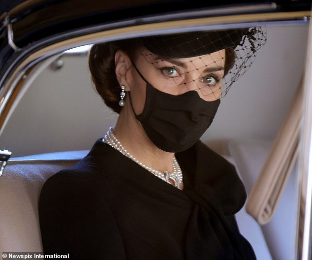 Above, the fast-becoming-iconic picture of Gary's famous niece looking out of a car window on the day of Prince Philip's funeral. Clad in black, with only her eyes visible, Kate looked more regal than the royals-by-birth