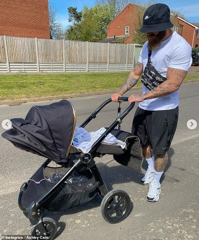 Family: He shared a gallery of images of his little girl nestled in her pram while they enjoyed the short outing