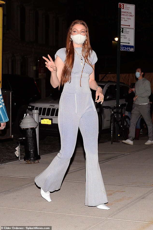 Gorgeous:Gigi showcased her post baby body in a knitted baby blue jumpsuit, which had a cut-out back detail