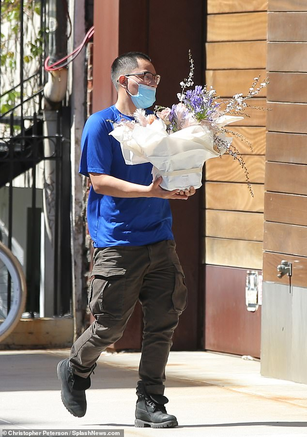 Earlier in the day: Two separate delivery men were seen delivering flowers to Gigi for her birthday, along with balloons