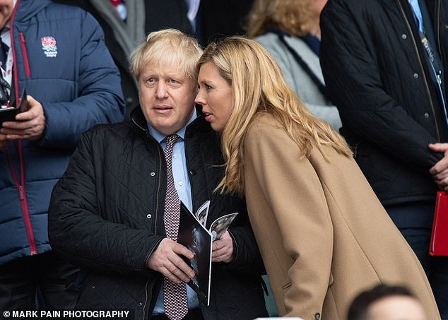 Boris Johnson, pictured with his fiance Carrie Symonds, right, is at the centre of a scandal